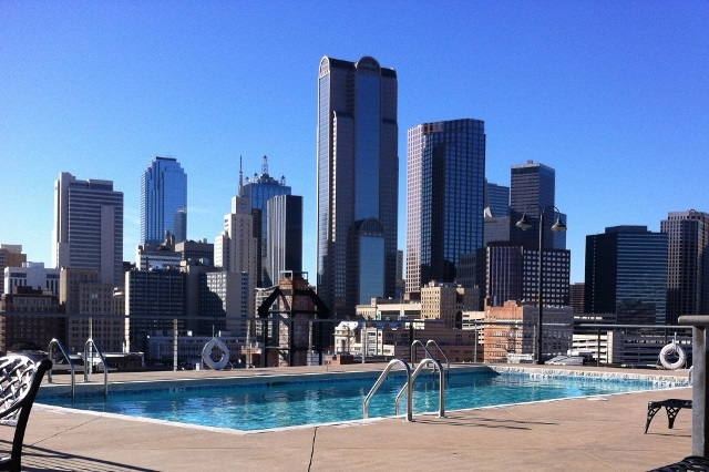 Leak Professionals Services: Pool with Dallas Skyline